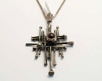 Garnet and silver cross pendant