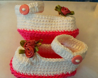 Hand-crocheted newborn Baby girl shoes.  Pink and white.