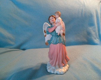 Angel and child Porcelain figurine