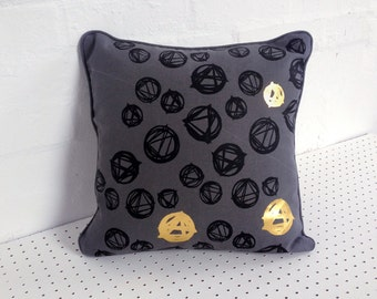 Screenprinted cushion cover in grey 100% linen, screen printed by hand with black and gold abstract design