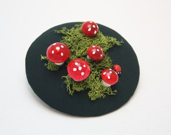 Fascinator toadstools in dark green with real Moss