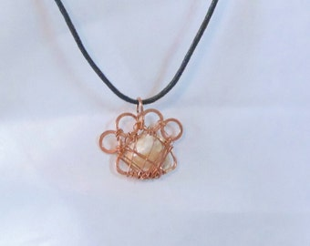 Copper and sea shell paw print