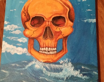 Gold Skull by the Ocean