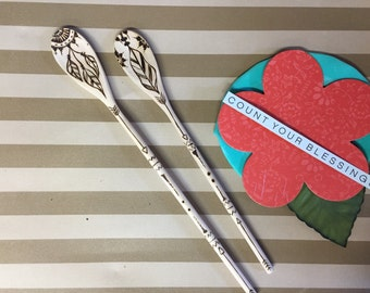 Feather design wood spoons.