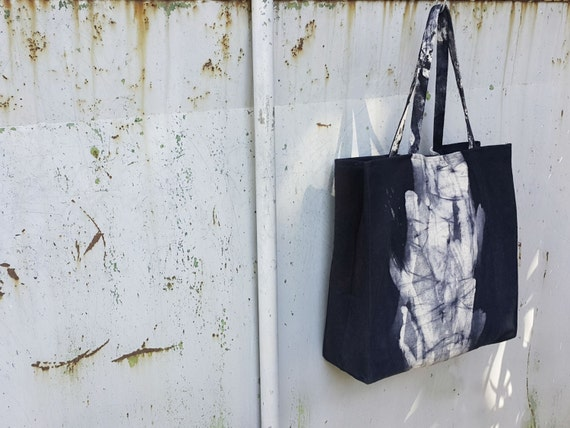 Nero Dash Sausalito - black canvas square tote bag with white dash in the middle by Canzone