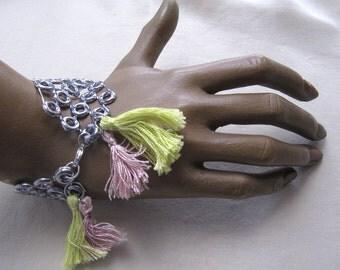 Bracelet woman, vinyl, silver colour, ponpoms.