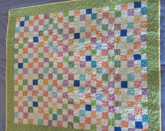 Homemade patchwork baby quilt