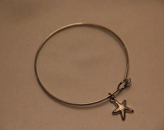 Silver bracelet with starfish charm