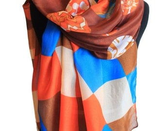 Blue, fawn, orange rectangular scarf with a brown base