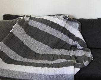 Hand knitted white grey striped blanket