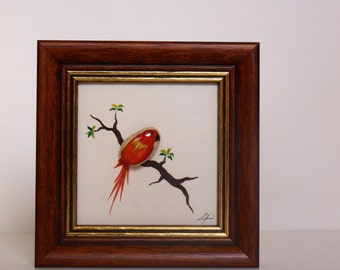 Stone image motif: red parrot