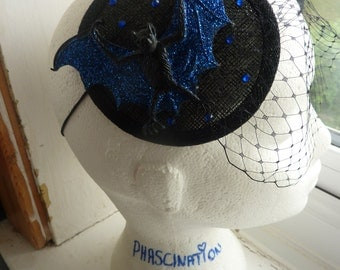 Blue glitter bat veiled fascinator