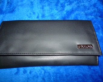 Tri fold traveling jewelry case by Bulova