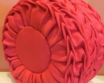 Round pink/peach polyester decorative pillow