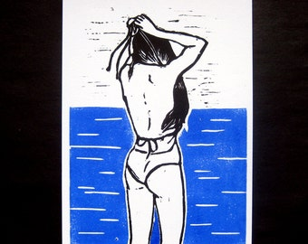 linocut, woman bather, swimsuit, burning blue and black