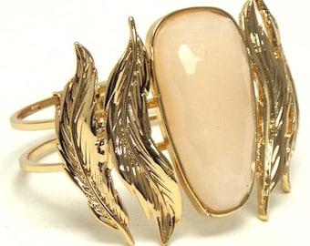 Facet stone and metal leaf hinge cuff bracelet