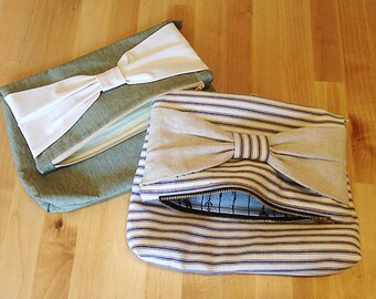 Large, foldable clutch or makeup bag with bow