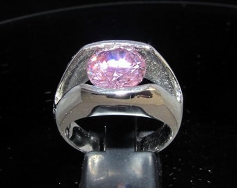 Sterling silver Solitaire ring with diamond cut pink CZ