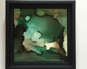 Green abstract alcohol ink painting on 6x6 clay board. Sealed and Mounted in black floating frame 7.5 x7.5 ready to hang.