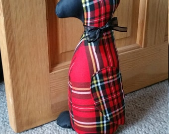 Duck doorstop. Red tartan fabric