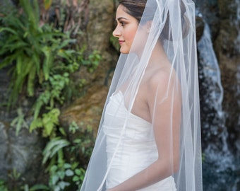 Fingertip length veil with satin ribbon edge
