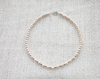 Silver and faux pearl necklace