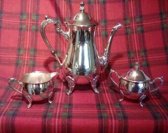 Silver plate coffee pot creamer and sugar bowl
