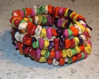 Bracelet of semi-precious stone turquoise chips,multicolor, 4 rows on memory wire.
