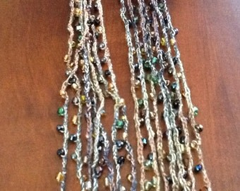 Crochet necklace with beads green gold browns
