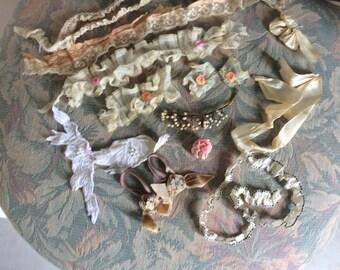 Antique fragments of silk ribbon, velvet, enamel,appliqués, lace and wax bud branch