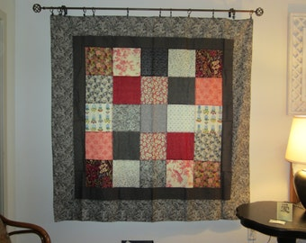 Gray and red patchwork tablecloth