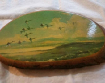 Picture of birds flying south on wood. 1980's style.