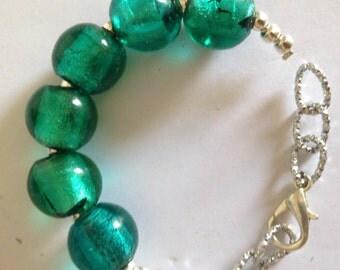 Metal bracelet with round glass