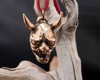 bronze necklace of Hannya japanese demon.