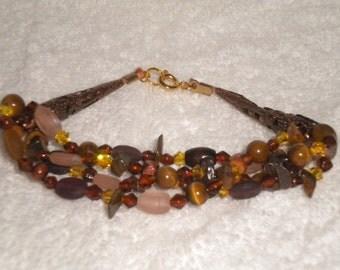 Brown and antique gold bracelet