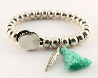 Bracelet with beads, feather and pompon
