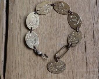 Brass bracelet hand engraved.