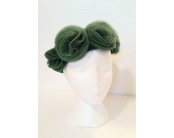 Green vintage hat with tulle flowers