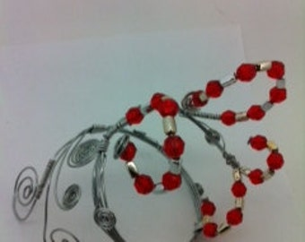 Cuff bracelet with red and silver beads.