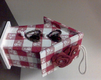 red and white checkered birdhouse