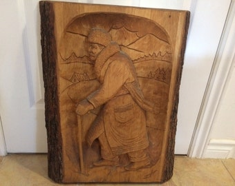 Sculpture of a trapper signed