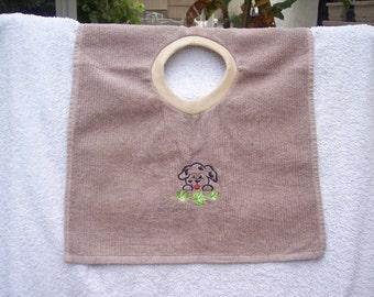 Embroidered towel bib