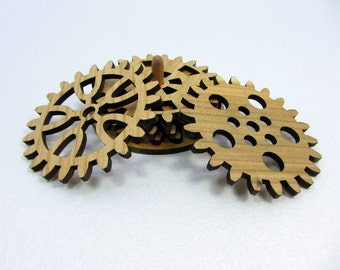 Mugmats nice gift. Set circles under glass in the form of gears made of plywood.