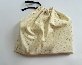 "12""x12"" Cotton Dust Cover for a Purse - cream-yellow numbers print"