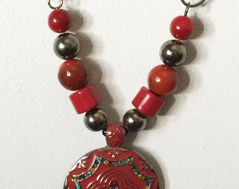 Red circle pendant necklace with beautiful designs.
