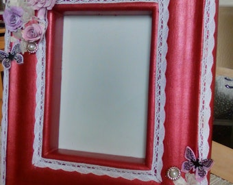 Very Heavy Solid Wood Ornimented Frame.