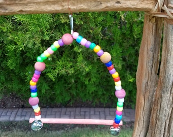 colorful bird swing with bells
