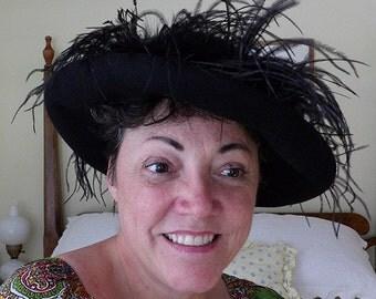 Black felt dress hat with feathers