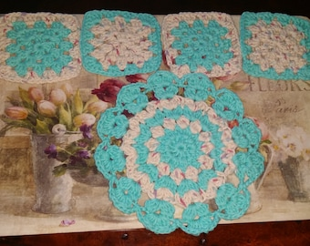 crocheted  potholder and four  coasters