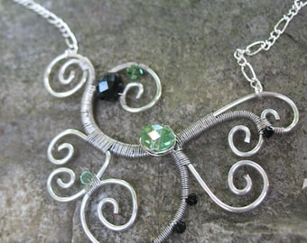 Wire wrapped necklace with glass bead and swarovski crystals